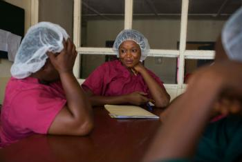Medical staff discuss a patient in the Lassa Fever Ward at Kenema Government Hospital, Sierra Leone. Lassa fever is a rodent-borne, acute viral haemorrhagic illness endemic to parts of West Africa.