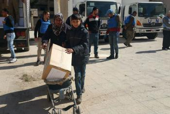 UNRWA delivers humanitarian aid to civilians in Yalda, including those displaced from Yarmouk camp in Syria. File
