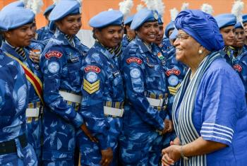 President Ellen Johnson-Sirleaf (left) with members of the all-female Indian Formed Police Unit serving with the UN Mission in Liberia.