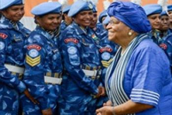 Ellen Johnson-Sirleaf (left) with members of the all-female Indian Formed Police Unit in Liberia.