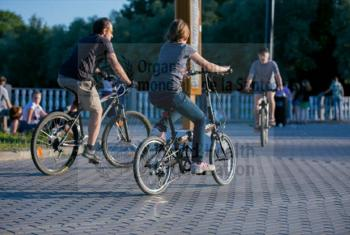 A man and a young girl are riding bikes in Izmailovsky park, Moscow, Russia. WHO /Sergey Volkov