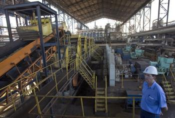 An employee of the Moema Mills inspecting the daily operation of the sugar mill.