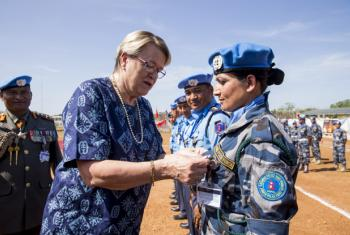 The Nepalese Formed Police Unit and UN Police contingent from the United Nations Mission in South Sudan (UNMISS) received awards at the medal parade ceremony in Juba. Ellen Margrethe Løj (centre left), pins a medal to an UNMISS officer.