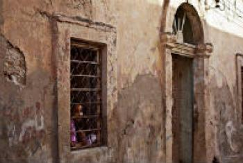 A girl looks out of her house window in Benghazi, Libya. File