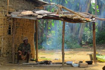 A woman outside her home in the village of Imbong, near Mekambo in Gabon's northeastern Ogooué-Ivindo province.