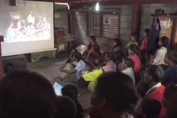 Villagers in Laos watching 'My Happy Family,' a soap opera that teaches proper nutrition. (Screen grab from IFAD TV)