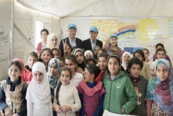 World Bank President Jim Yong Kim, UN Secretary-General Ban Ki-moon and Mrs Ban with children at Zaatari refugee camp in Jordan. (UN