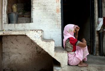 A woman outside her small home in Kanpur, Uttar Pradesh,