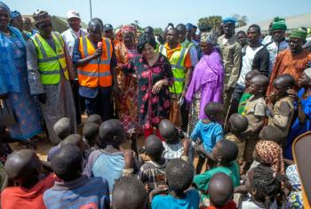 Special Representative of the Secretary-General for Children and Armed Conflict Leila Zerrougui (centre), meets displaced children and their families in northeastern Nigeria, in January 2015.