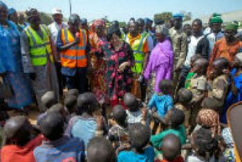 Leila Zerrougui (centre) meets displaced children and their families in northeastern Nigeria. File
