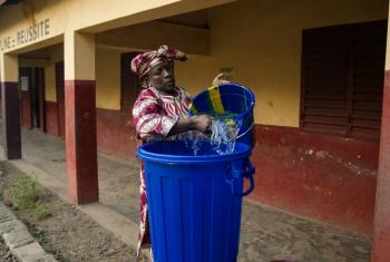 A teacher prepares water for hand-washing in Guinea, which has just seen its first flare-up of Ebola since the original outbreak was declared over at the end of 2015.
