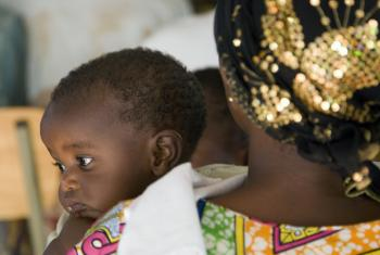 """Mother and Child at the """"Village of Hope""""- Rwanda Women's Network community centre -- an initiative to provide services and emergency housing to women victims of rape and other violent crimes committed during the Rwandan genocide."""