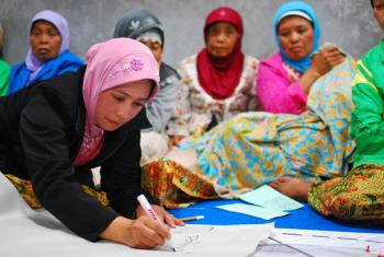 In Yogyakarta, Indonesia, women at a community meeting discuss the reconstruction of their village in the wake of the 2006 tsunami and earthquake.