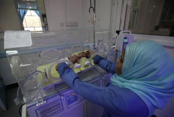 A nurse taking care of an infant child in an incubator at the Al-Sabeen Hospital in Sana'a. Hospitals and clinics in Yemen have been paralyzed by the war: they have either been attacked, run out of medical supplies and fuel or the medical staff have been