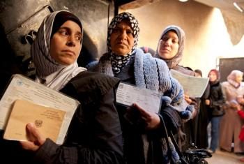 Palestinian women at a UNRWA distribution centre in the Jaramana refugee camp, Damascus, Syria.