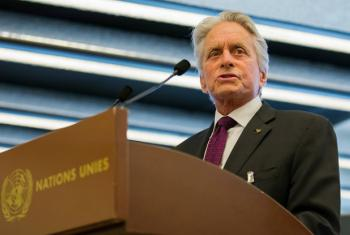 Michael Douglas, UN Messenger of Peace, honours the winners of the UN's Disarmament Poster for Peace Competition at the Palais des Nations in Geneva.