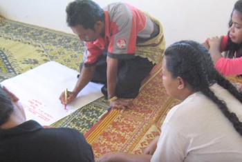 Community meeting in Hunga island, Tonga. (Screen grab from IFAD Video)