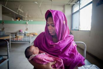 A mother and her newborn baby at the Maternal and Child Health Training Institute for medically needy in Dhaka. UN File Photo/Kibae Park
