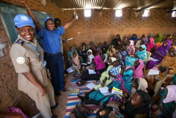 Women in Abu Shouk Camp for internally displaced persons (IDPs) near El Fasher, North Darfur, attend English classes conducted by volunteer teachers and facilitated by the police component of the African Union-United Nations Hybrid Operation in Darfur (UN