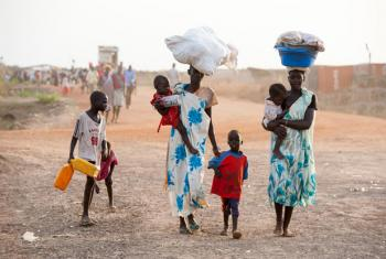 Women and children arrive in the Bentiu Protection of Civilians site for internally displaced people, in Unity State, South Sudan.