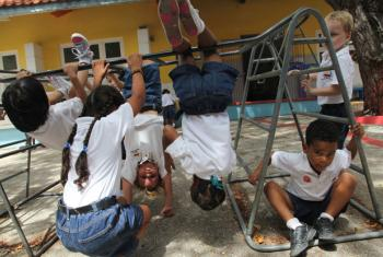 Children play outdoors at a school in Curaçao, the Netherlands.