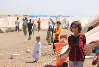 Yazidi refugees, including several children, go about their lives in Nawrouz refugee camp, approximately 40 kilometres from the Syrian border with Iraq.
