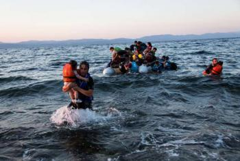A group of Syrian refugees arrive on the island of Lesbos after travelling in an inflatable raft from Turkey, near Skala Sykaminias, Greece.