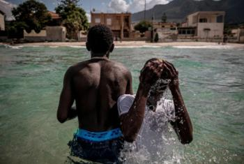 Twins Aimamo and Ibrahim, 16, in Trabia, Italy. The pair worked for two months in slave-like conditions in Libya to pay smugglers for their passage to Europe.
