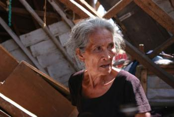 Seventy-seven-year-old Anacleta struggles to subsist in her storm-ravaged home following Typhoon Haiyan, which struck the Philippines in 2013. File
