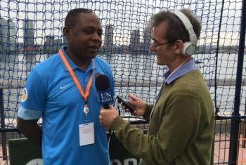 Football player Kalusha Bwalya being interviewed by Daniel Dickinson.