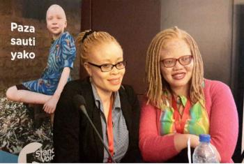 Ikponwosa Ero, UN Indendepent Expert on Albinism (left), and a participant at three-day Action on Albinism in Africa forum in Dar es Salaam, Tanzania.