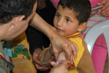 A Syrian boy gets his measles jab in Zaatari refugee camp in Jordan.