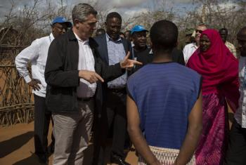 UN High Commissioner for Refugees Filippo Grandi talks to a Somali refugee family during his visit in Ifo Camp in Dadaab, Kenya.