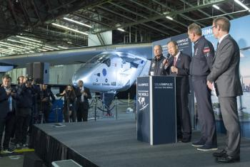 From left: Bertrand Piccard, UN Secretary General Ban Ki-moon, André Borschberg, and UN representative from Switzerland, Olivier Zehnder with Solar Impulse in the background.
