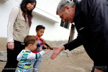 UN High Commisioner for Refugees, Filippo Grandi, meets with Colombia refugee family living in Ecuador who opened small business with UNHCR help.