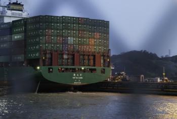 A cargo ship moves through the Panama Canal.