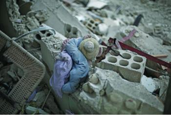 In East Ghouta, rural Damascus, a child's plush toy lies in the rubble of a destroyed building. (file)