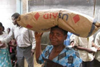 In Malawi, a woman picks up her monthly ration of supercereal.