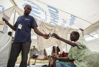An elderly man is given the Hepatitis E vaccine on arrival at a camp in South Sudan.