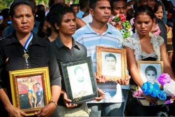 Citizens display photographs of loved ones who died or who disappeared on 12 November 1991 when the Indonesian military opened fire on a group of pro-independence supporters during a peaceful demonstration.