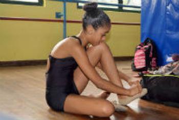Adrielle Alexandre, a young athlete from Rio de Janeiro, Brazil, prepares for a ballet class.
