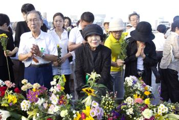 Participants of the annual Hiroshima Peace Memorial Ceremony, in Hiroshima, Japan, mourn and pray in memory of victims of the 1945 atomic bomb.
