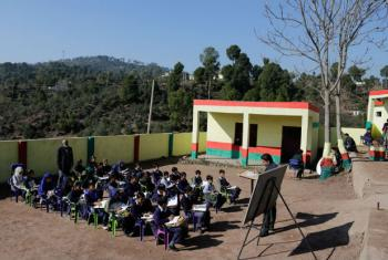 Children attend class in open at a government middle school, Karian district Rajouri, Jammu and Kashmir, India.