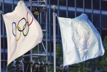 The United Nations and the Olympic flags.