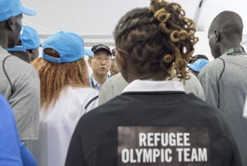Secretary-General Ban Ki-moon meets with members of the Refugee Olympic Athletes team in the Olympic Village in Rio de Janeiro, Brazil.