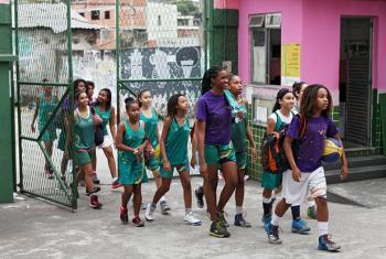 Girls meet at the Olympic Vila of Mangueira, Rio de Janeiro, Brazil.