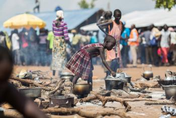 A young South Sudanese refugee cooks food at a camp in northern Uganda