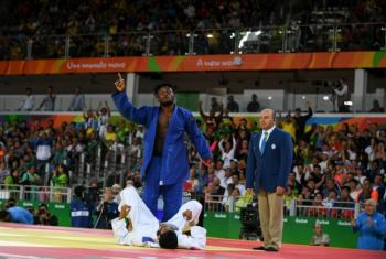 Popole Misenga celebrates the first-ever win of a refugee athlete in the Olympic Games.