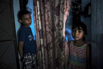 On 1 July 2016, (left-right) Angel, 12 and his sister Valeria, 4, in El Progreso, Honduras. Together with his father, Pedro, and his siblings, they were kidnapped in Mexico and held hostage for 42 days.