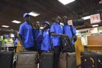 Sudanese refugees prepare to fly from Kenya to Brazil.